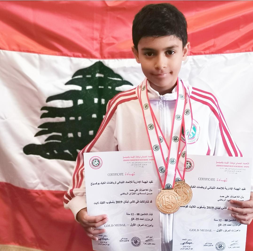 علي أمير حمد يتوج بطل لبنان وأسيا في الكيك بوكسينغ ويفوز بذهبيتين